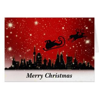 Père Noël et Sleigh au-dessus de grande ville Carte De Vœux