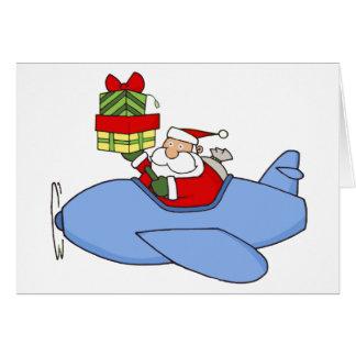 Père Noël fournit des présents dans l'avion Cartes