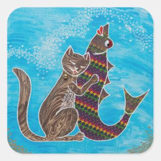 Petit autocollant arrondi avec le chat et les