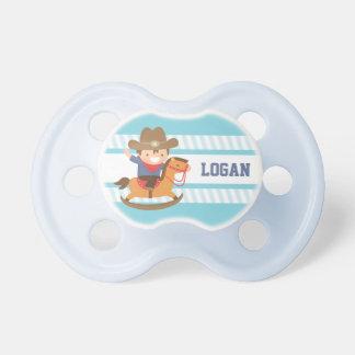 Petit cowboy mignon sur des bébés de cheval de sucettes pour bébé