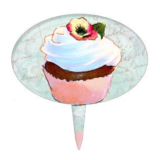Petit gâteau rose avec la pensée piques à gâteaux