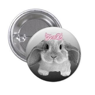 Petit lapin adorable avec un arc rose