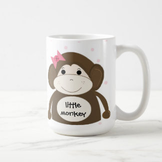 Petit singe avec un arc rose de cheveux mug