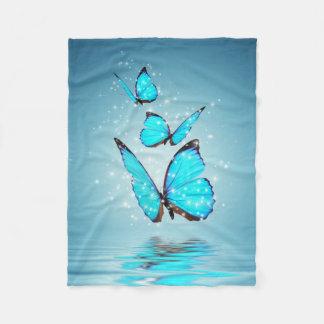 Petite couverture d'ouatine de papillons magiques
