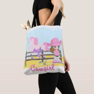 Petite cow-girl avec le sac fourre-tout à cheval