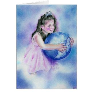 Petite fille tenant la carte de la terre de globe
