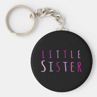 Petite soeur dans le rose porte-clef