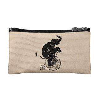 Petite Trousse De Maquillage Silhouette noire d'éléphant montant un vélo