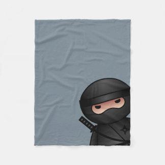Peu de guerrier de Ninja sur le gris Couverture Polaire