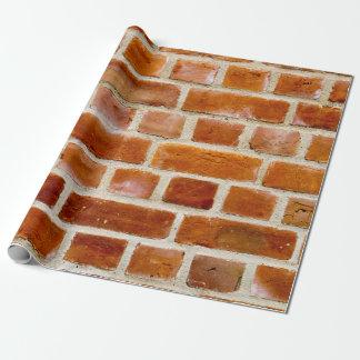 Photo de mur de briques papiers cadeaux noël