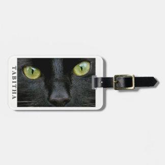 Photo de yeux verts de chat noir étiquette à bagage