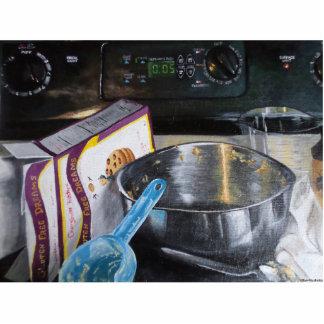 Photo Sculpture Cuisson dans la cuisine peignant la silhouette de