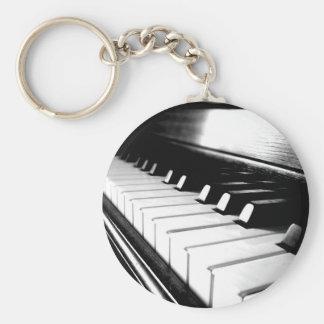 Photographie noire et blanche chique de piano porte-clé rond