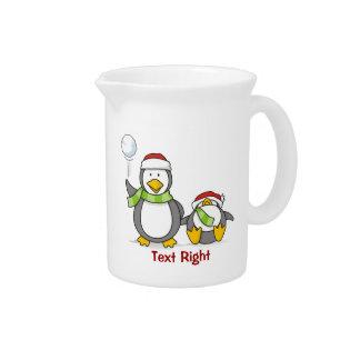Pichet Noël lançant des boules de neige des pingouins