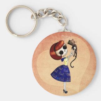 Pin de squelette vers le haut de fille avec son porte-clés