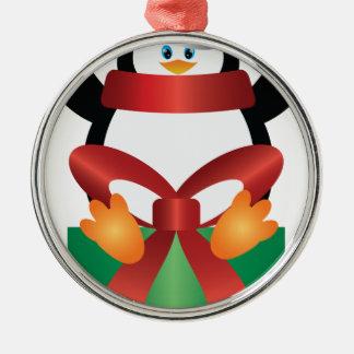 Pingouin avec le casquette de Père Noël sur Ornement Rond Argenté
