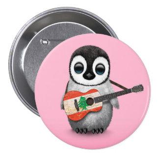 Pingouin de bébé jouant le rose libanais de badge