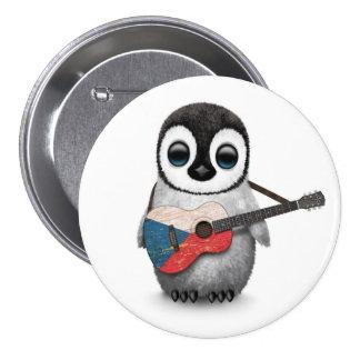 Pingouin jouant la guitare de drapeau de badge