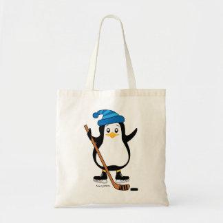 Pingouin mignon d'hockey avec le bâton de hockey tote bag