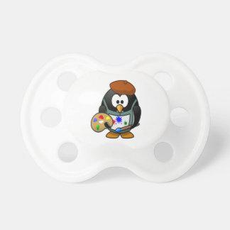 Pingouin tenant une palette d'art sucettes pour bébé