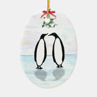 Pingouins et ornement de vacances de gui