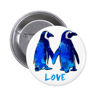 Pingouins tenant la conception d'amour de mains badges