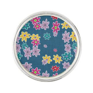 Pin's Arrière - plan bleu avec le motif de fleurs coloré