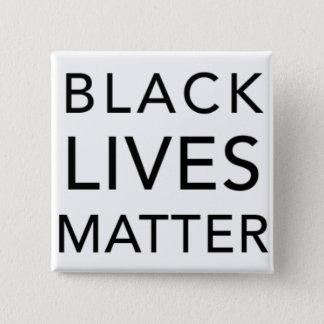 Pin's Bouton noir de matière des vies