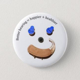 Pin's bouton souriant de visage de meilleure audition
