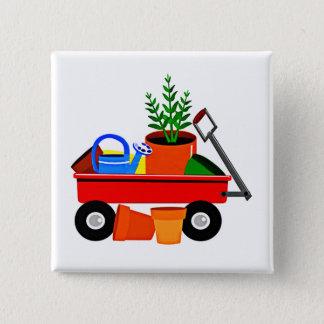 Pin's Chariot rouge avec des plantes et des outils de
