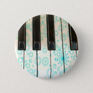 Pin's Clés de piano avec des cercles d'Aqua