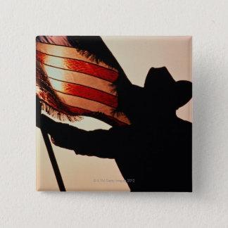 Pin's Cowboy tenant la bannière étoilée, silhouette,