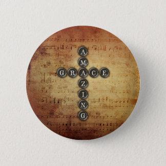 Pin's Croix extraordinaire de grâce sur la feuille de