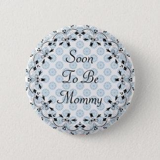 Pin's Être bientôt bouton bleu et noir de maman