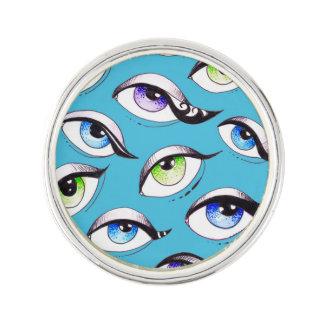 Pin's Groupe de yeux bleus