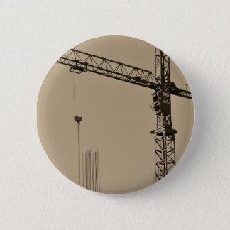 Pin's Grue de construction de sépia