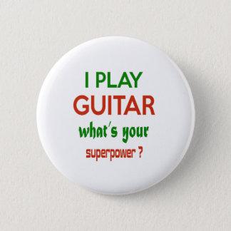 Pin's Je joue la guitare ce qui est la votre