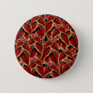 Pin's Motif rouge de feuille sur le noir