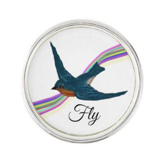 Pin's Oiseau bleu doux avec l'arc-en-ciel stylisé