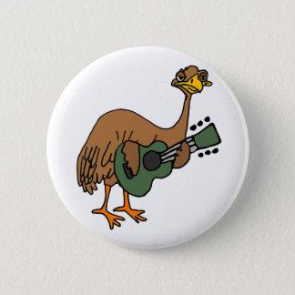 Pin's Oiseau drôle d'émeu jouant la bande dessinée de