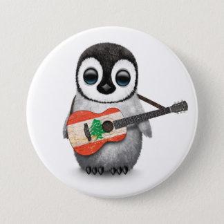 Pin's Pingouin de bébé jouant la guitare libanaise de