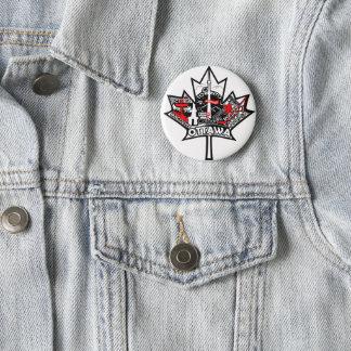 Pin's Un bouton avec la feuille d'érable du Canada