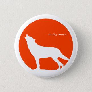 Pin's Un mouton pleurant de loup - bouton