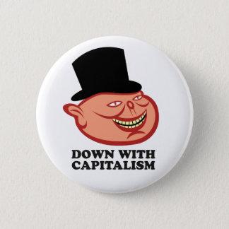 Pin's Vers le bas avec le bouton de capitalisme