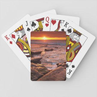 Piscines de marée au coucher du soleil, la cartes à jouer