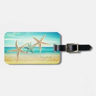 Plage tropicale, ciel bleu, sable d'océan, étoile étiquette à bagage