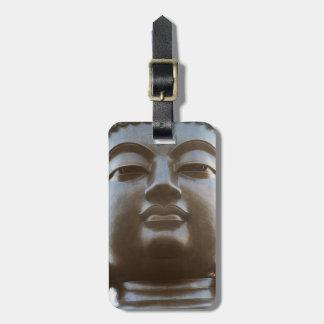 Plan rapproché de statue de Bouddha Étiquettes Bagages