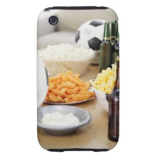 plan rapproché d'un à télécommande avec des coque tough iPhone 3