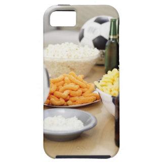 plan rapproché d'un à télécommande avec des coques iPhone 5 Case-Mate