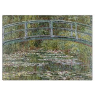 Planche À Découper Pont au-dessus d'un étang des nénuphars par Claude
